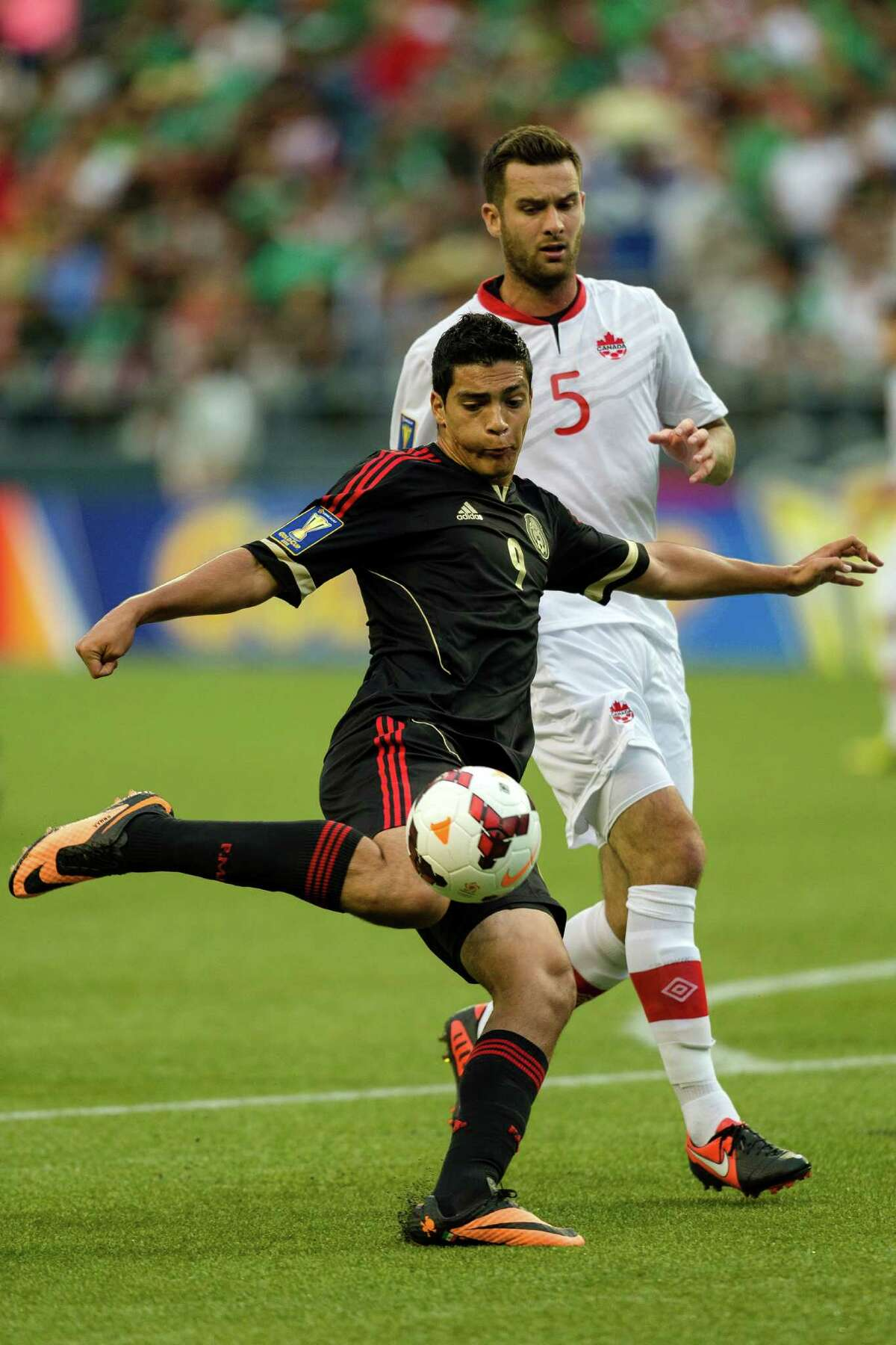 Raul Jimenez, foreground, prepares to shoot on the Canadian goal during the first half of the Mexico versus Canada CONCACAF Gold Cup soccer match Thursday, July 11, 2013, at CenturyLink Field in Seattle. Mexico led Canada 1-0 at the end of the first half and later won the game 2-0.