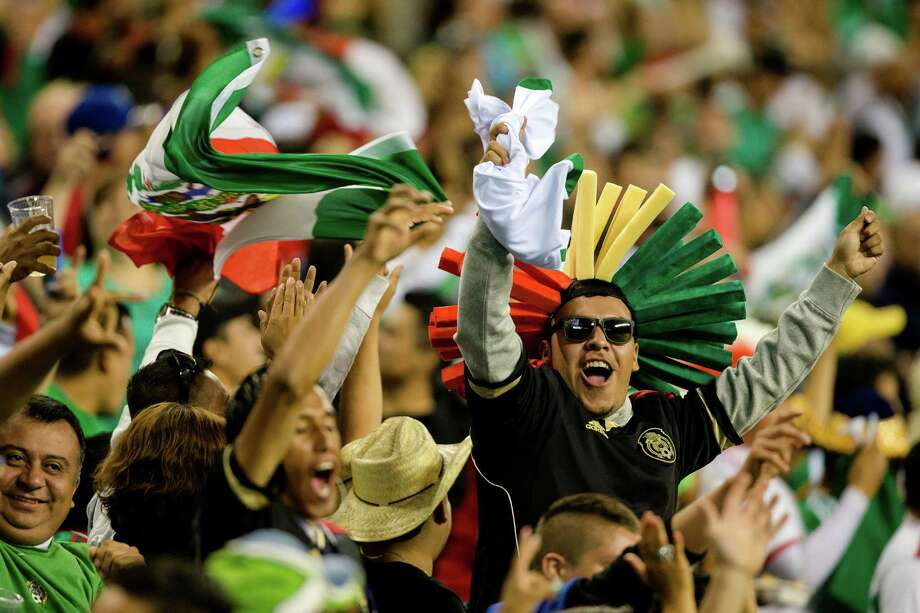 Fans rejoice after a goal for Mexico during the second half of the Mexico versus Canada CONCACAF Gold Cup soccer match Thursday, July 11, 2013, at CenturyLink Field in Seattle. Mexico led Canada 1-0 at the end of the first half and later won the game 2-0. Photo: JORDAN STEAD, SEATTLEPI.COM / SEATTLEPI.COM