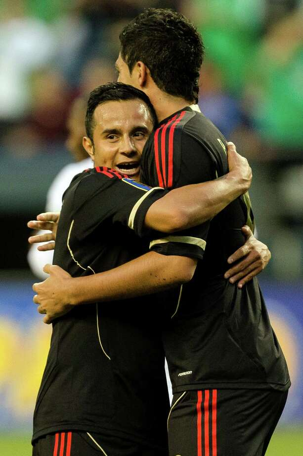 Raul Jimenez, right, is embraced by teammates following his successful shot on goal during the first half of the Mexico versus Canada CONCACAF Gold Cup soccer match Thursday, July 11, 2013, at CenturyLink Field in Seattle. Mexico led Canada 1-0 at the end of the first half and later won the game 2-0. Photo: JORDAN STEAD, SEATTLEPI.COM / SEATTLEPI.COM