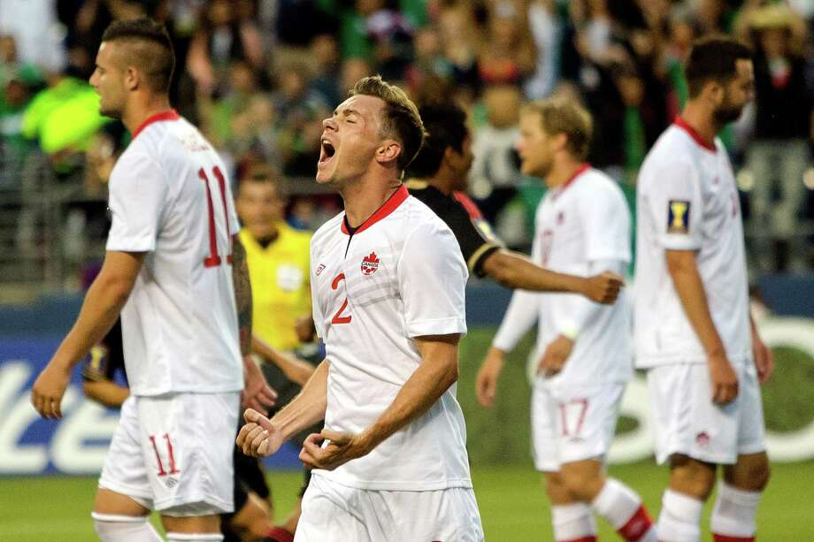Canada's Nikolas Ledgerwood, center left, reacts to a goal scored against his team during the first half of the Mexico versus Canada CONCACAF Gold Cup soccer match Thursday, July 11, 2013, at CenturyLink Field in Seattle. Mexico led Canada 1-0 at the end of the first half and later won the game 2-0. Photo: JORDAN STEAD, SEATTLEPI.COM / SEATTLEPI.COM