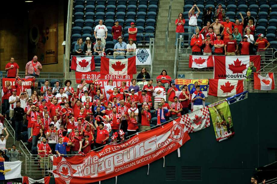 A modest section of Canadian fans cheer from the corner of the stadium during the first half of the Mexico versus Canada CONCACAF Gold Cup soccer match Thursday, July 11, 2013, at CenturyLink Field in Seattle. Mexico led Canada 1-0 at the end of the first half and later won the game 2-0. Photo: JORDAN STEAD, SEATTLEPI.COM / SEATTLEPI.COM