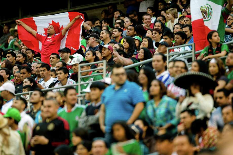 A lone Canadian fan shows his appreciation in a sea of Mexico fans during the first half of the Mexico versus Canada CONCACAF Gold Cup soccer match Thursday, July 11, 2013, at CenturyLink Field in Seattle. Mexico led Canada 1-0 at the end of the first half and later won the game 2-0. Photo: JORDAN STEAD, SEATTLEPI.COM / SEATTLEPI.COM