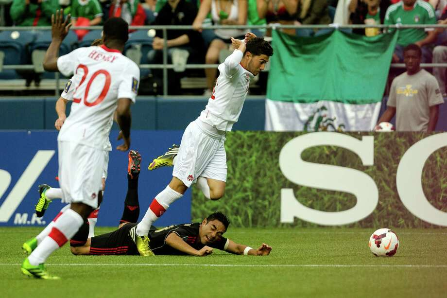 Canada's Jonathan Osorio, center, sails over an opponent during the first half of the Mexico versus Canada CONCACAF Gold Cup soccer match Thursday, July 11, 2013, at CenturyLink Field in Seattle. Mexico led Canada 1-0 at the end of the first half and later won the game 2-0. Photo: JORDAN STEAD, SEATTLEPI.COM / SEATTLEPI.COM