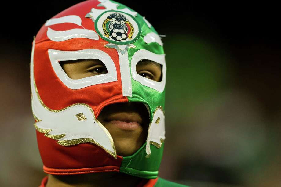 A fan shows his spirit in a luchador mask during the first half of the Mexico versus Canada CONCACAF Gold Cup soccer match Thursday, July 11, 2013, at CenturyLink Field in Seattle. Mexico led Canada 1-0 at the end of the first half and later won the game 2-0. Photo: JORDAN STEAD, SEATTLEPI.COM / SEATTLEPI.COM
