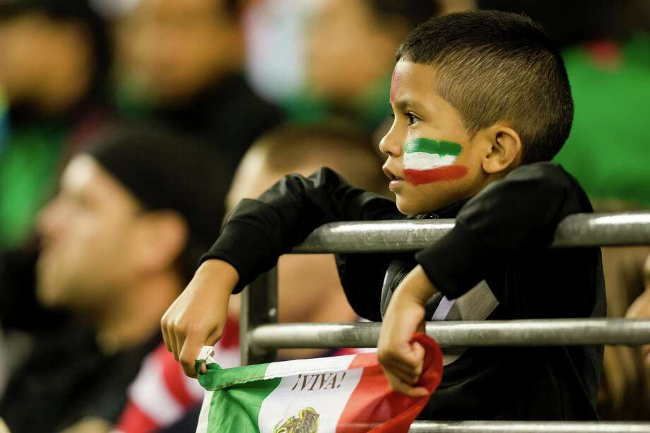 With flag in hand, a child watches the second half of the Mexico versus Canada CONCACAF Gold Cup soccer match Thursday, July 11, 2013, at CenturyLink Field in Seattle. Mexico led Canada 1-0 at the end of the first half and later won the game 2-0. Photo: JORDAN STEAD, SEATTLEPI.COM / SEATTLEPI.COM