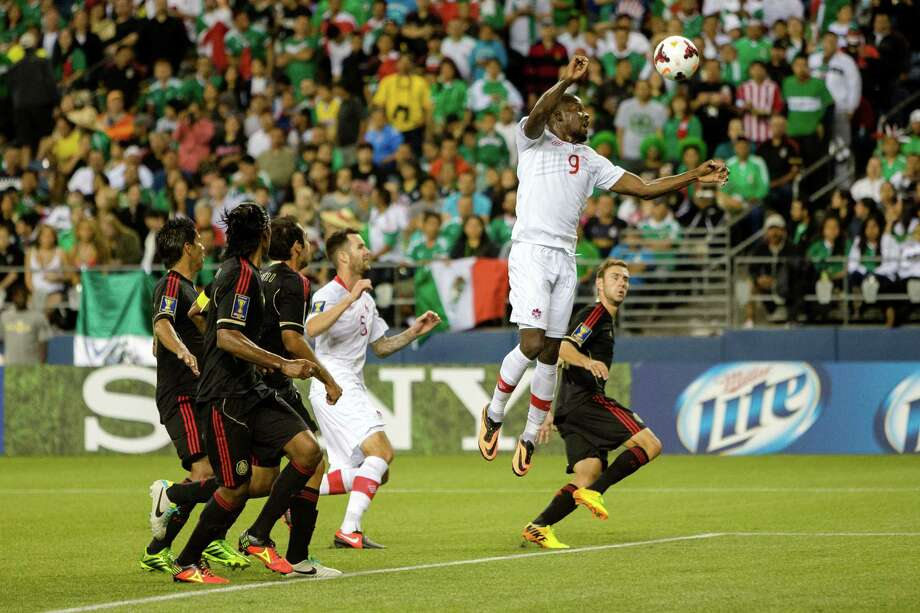 Canada's William Johnson, center right, goes up for a header during the second half of the Mexico versus Canada CONCACAF Gold Cup soccer match Thursday, July 11, 2013, at CenturyLink Field in Seattle. Mexico led Canada 1-0 at the end of the first half and later won the game 2-0. Photo: JORDAN STEAD, SEATTLEPI.COM / SEATTLEPI.COM