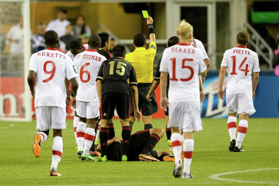 A yellow card is pulled by a ref following an intentional kick of a player by an opponent during the second half of the Mexico versus Canada CONCACAF Gold Cup soccer match Thursday, July 11, 2013, at CenturyLink Field in Seattle. Mexico led Canada 1-0 at the end of the first half and later won the game 2-0. Photo: JORDAN STEAD, SEATTLEPI.COM / SEATTLEPI.COM