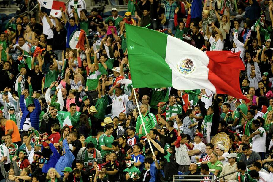 Mexico fans wave flags and rejoice following a goal against Canada during the second half of the Mexico versus Canada CONCACAF Gold Cup soccer match Thursday, July 11, 2013, at CenturyLink Field in Seattle. Mexico led Canada 1-0 at the end of the first half and later won the game 2-0. Photo: JORDAN STEAD, SEATTLEPI.COM / SEATTLEPI.COM
