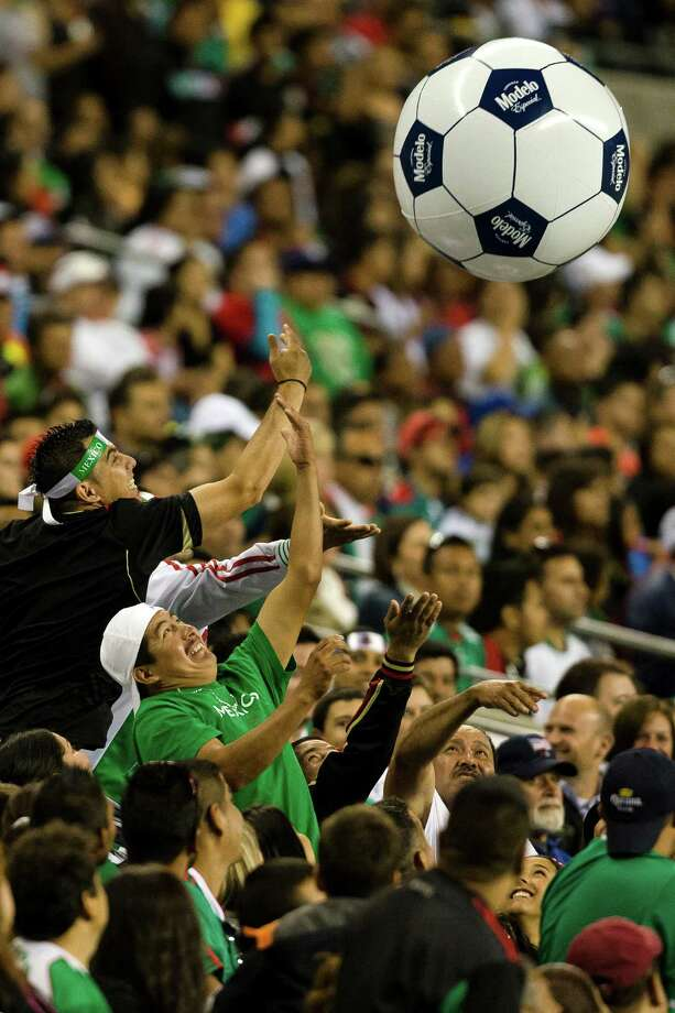 Fans reach to bat around an inflatable soccer ball during the second half of the Mexico versus Canada CONCACAF Gold Cup soccer match Thursday, July 11, 2013, at CenturyLink Field in Seattle. Mexico led Canada 1-0 at the end of the first half and later won the game 2-0. Photo: JORDAN STEAD, SEATTLEPI.COM / SEATTLEPI.COM