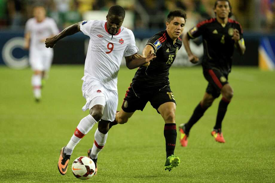 Canada's Tosaint Ricketts, left, charges downfield past Mexico defense during the second half of the Mexico versus Canada CONCACAF Gold Cup soccer match Thursday, July 11, 2013, at CenturyLink Field in Seattle. Mexico led Canada 1-0 at the end of the first half and later won the game 2-0. Photo: JORDAN STEAD, SEATTLEPI.COM / SEATTLEPI.COM