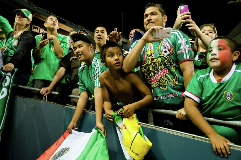 Young fans scramble to get autographs following the second half of the Mexico versus Canada CONCACAF Gold Cup soccer match Thursday, July 11, 2013, at CenturyLink Field in Seattle. Mexico led Canada 1-0 at the end of the first half and later won the game 2-0. Photo: JORDAN STEAD, SEATTLEPI.COM / SEATTLEPI.COM