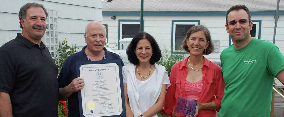 Westport was recognized for winning the state's Neighbor-to-Neighbor Energy Challenge to promote home energy efficiency. Paictured at a Thursday night celebration of that status, are, from left, state Rep. Jonathan Steinberg, First Selectman Gordon Joseloff, state Rep. Gail Lavielle, Pippa Bell Ader, who chaired the initiative, and David Mann, the chairman of Westport's Green Task Force. Photo: Jarret Liotta / Westport News contributed