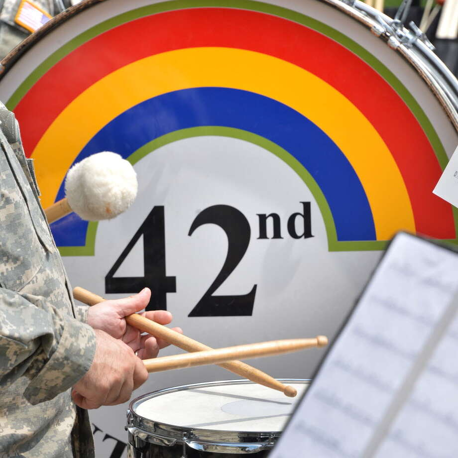 "The insignia of the 42nd Infantry Division ""Rainbow"" Band of the New York Army National Guard adorned a bass drum during a performance at West Capitol Park in Albany on July 18, 2012. (John Carl D'Annibale/Times Union)"