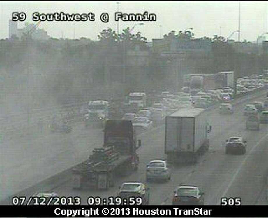 Traffic was snarled on the outbound Southwest Freeway after a traffic crash near Fannin Friday morning. Photo: Houston Transtar