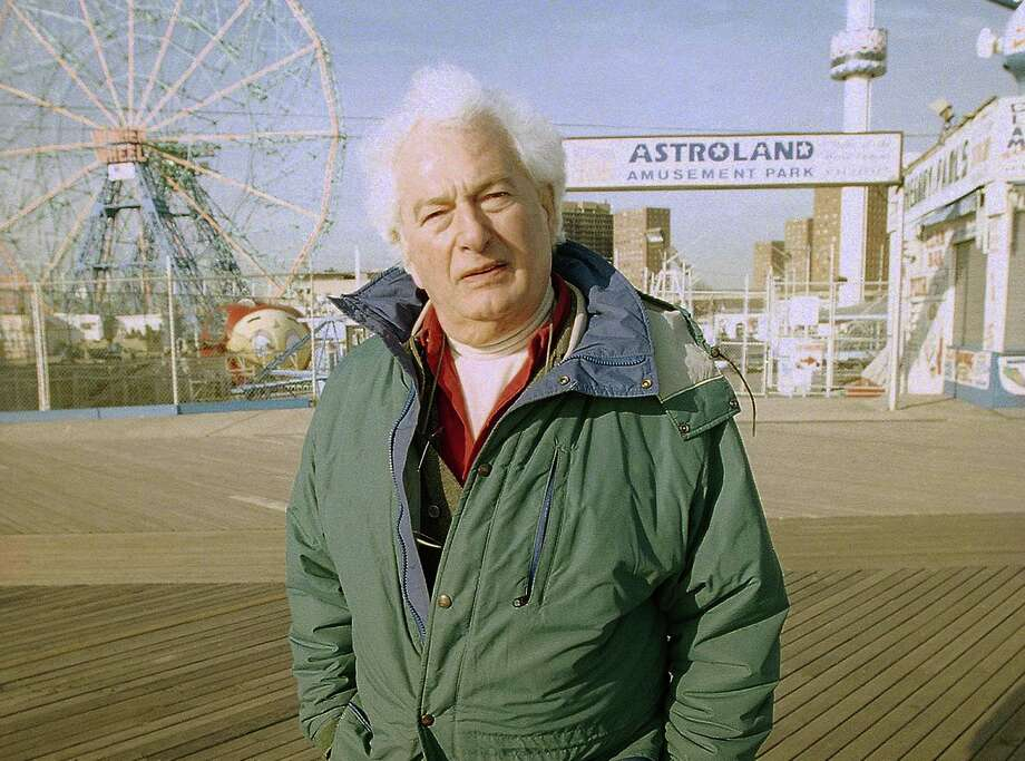 "FILE - This Jan. 26, 1998 file photo shows author Joseph Heller along the Coney Island boardwalk in the Brooklyn borough of New York. Heller's  short story, ""Almost Like Christmas,"" will appear next week in Strand Magazine. It is a about the stabbing of a Southern white, the town's thirst for revenge and the black man who has resigned himself to blame. Written in the late 1940s or early '50s, after Heller had returned from World War II, the story has rarely been seen and offers a peak at the early fiction of one of the 20th century's most famous writers. (AP Photo/Todd Plitt, File) Photo: Todd Plitt, STR / AP"