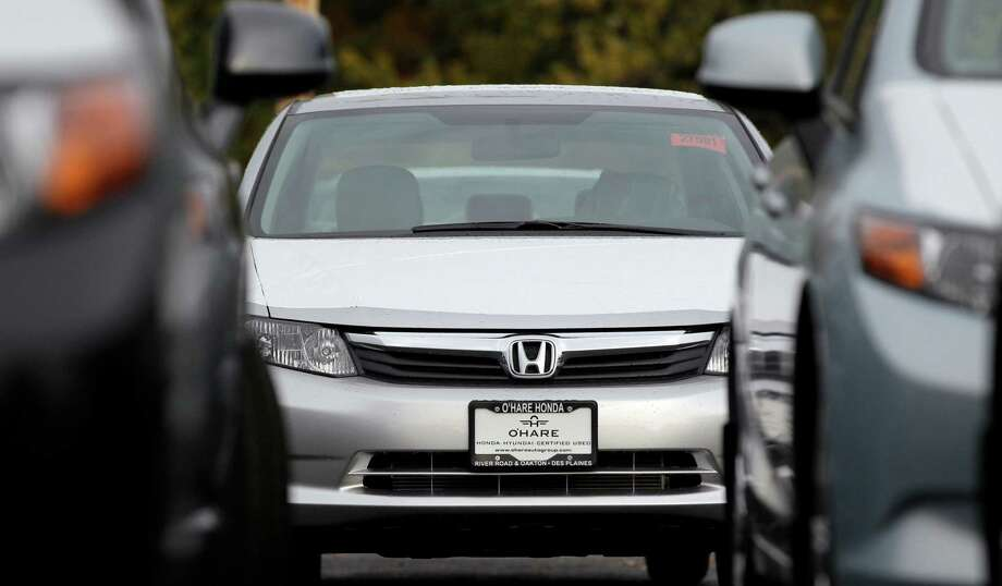 A Honda civic is seen outside of a Honda car dealership in Des Planines, Ill. Used cars have gotten more affordable, especially if you're looking for a small car or a hybrid. (AP Photo/Nam Y. Huh) Photo: Nam Y. Huh, Associated Press / Associated Press