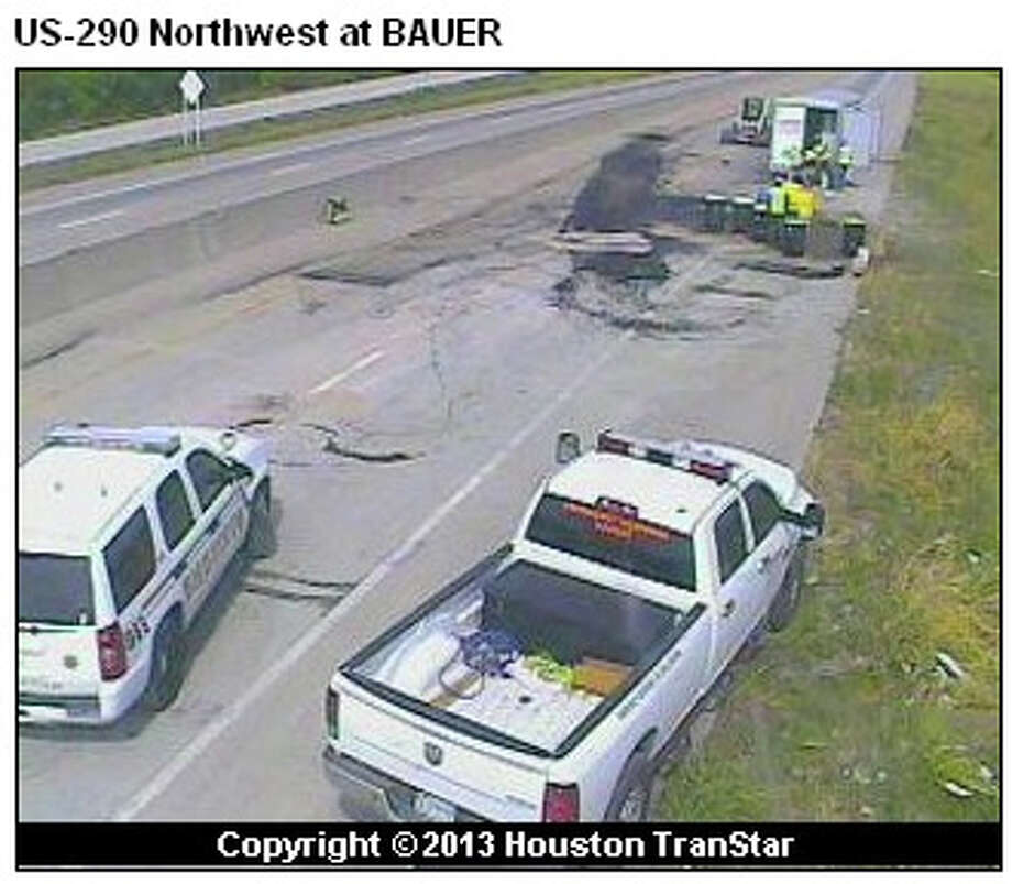 A Harris County sheriff's deputy slammed into a truck that had flipped over and spilled sand before dawn Friday on U.S. 290 at Bauer. Traffic was still being diverted before 11 a.m.