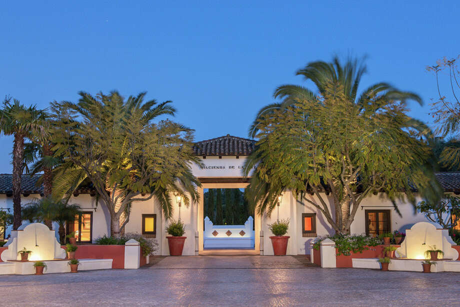 This California home has five stories underground and comes with some serious perks, including an indoor tennis court.The home, which is listed by Marcie Hartley of Hilton & Hyland, can be yours for a whopping $53 million. Photo: Courtesy of Mark Singer Photo: Mark Singer / Mark Singer Photography