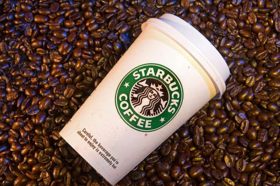 Starbucks recently gave an unusual glimpse into its most popular stores in America, which offered some surprises. Here's who beat out Seattle for Starbucks' busiest store and why Seattle's top performer is so unusual. It's followed by a look at the coolest and weirdest Starbucks in the world.   h/t StarbucksMelody. Photo: PAUL J. RICHARDS, AFP/Getty Images / 2009 AFP