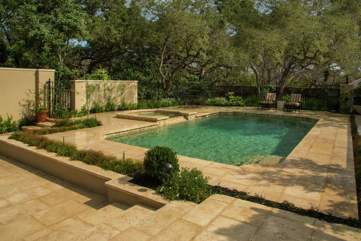 Landscape architect John Troy designed a pool remodel done by Artesian Pools. The makeover gave the pool new stone decking and coping along the edge, new tile along the waterline, a spa and a quartz-finish resurface.