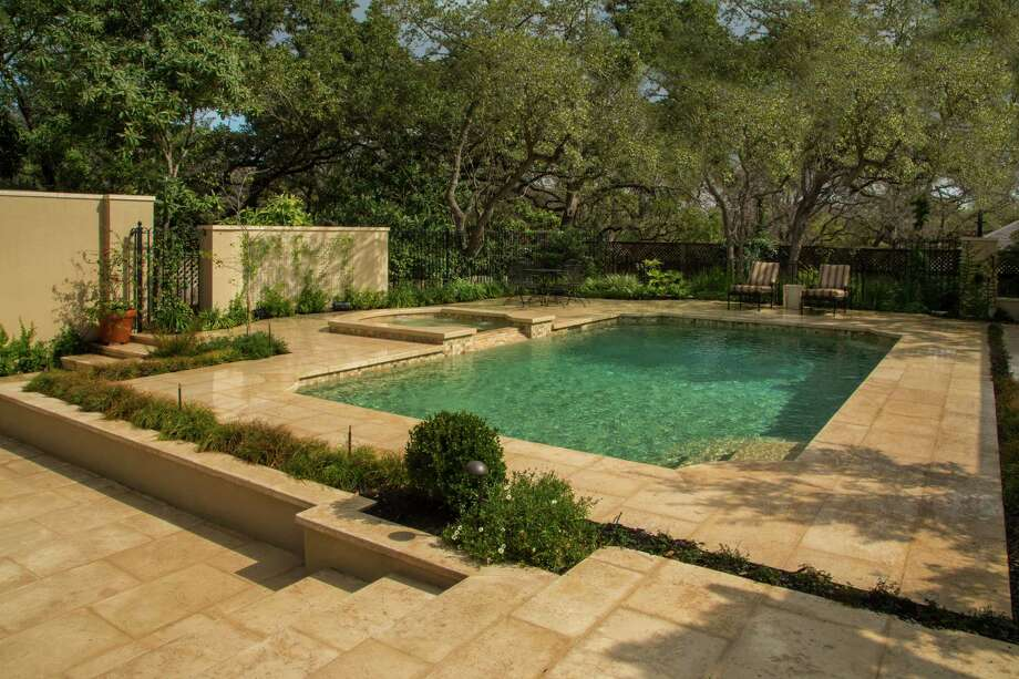 Landscape architect John Troy designed a pool remodel done by Artesian Pools. The makeover gave the pool new stone decking and coping along the edge, new tile along the waterline, a spa and a quartz-finish resurface. Photo: Courtesy Vernon Wentz