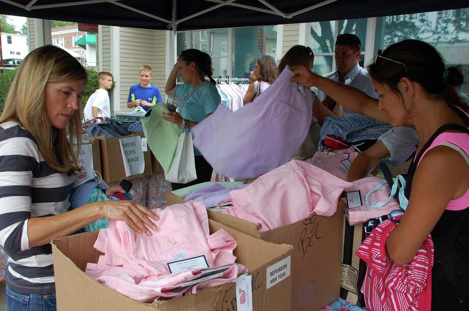 A crowd of shoppers descended on the bines of clothing set out by the Vineyard Vines store on Main Street, one of local stores participating in the Westport Sidewalk Sales this weekend. Photo: Jarret Liotta / Westport News contributed