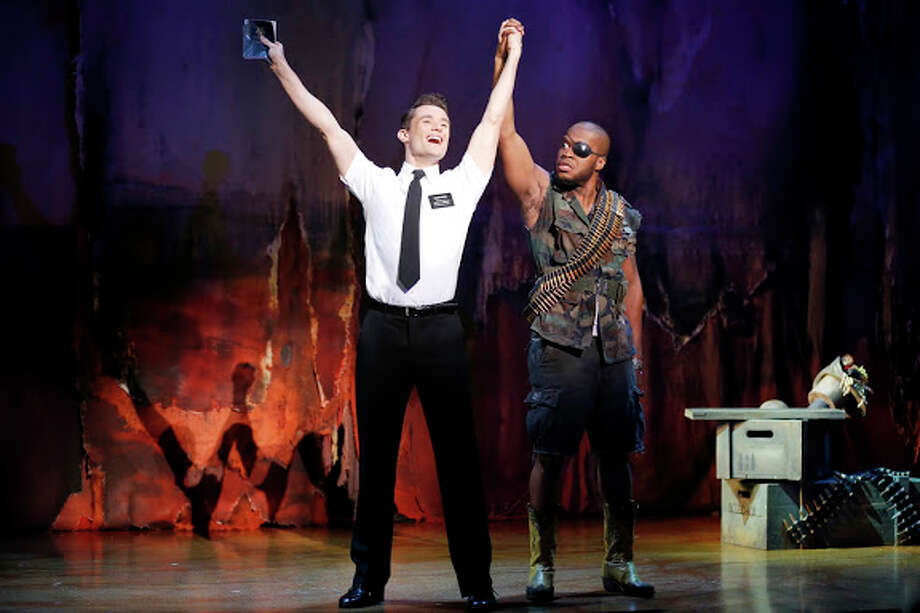 "Mark Evans (from left) and Derrick Williams appear in the national tour of ""The Book of Mormon.' Courtesy Joan Marcus Photo: Courtesy Photo"