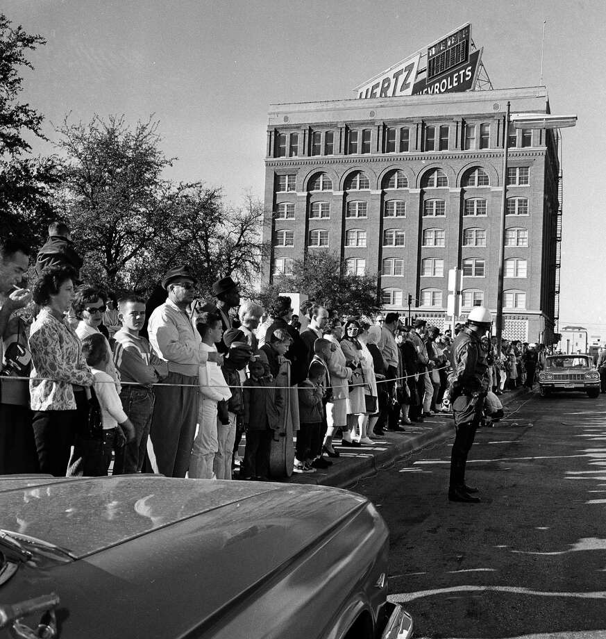 12:33 p.m., November 22, 1963: Assassin Lee Harvey Oswald leaves the Texas School Book Depository after interacting with a police officer and a supervisor, who said Oswald appeared calm. Photo: File