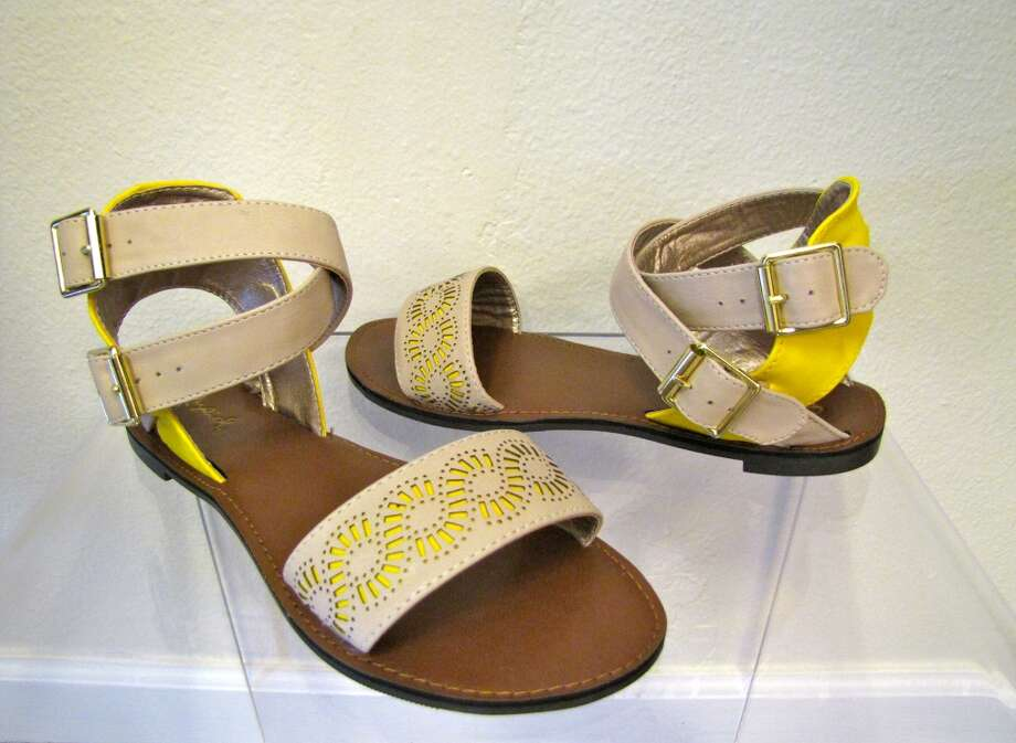 Two-tone perforated sandals, $29, Daisy Parc Boutique, Nederland