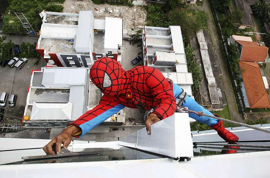 With crime downin Surabaya, East Java,Spider-Man is forced to find another line of work. Photo: Trisnadi, Associated Press