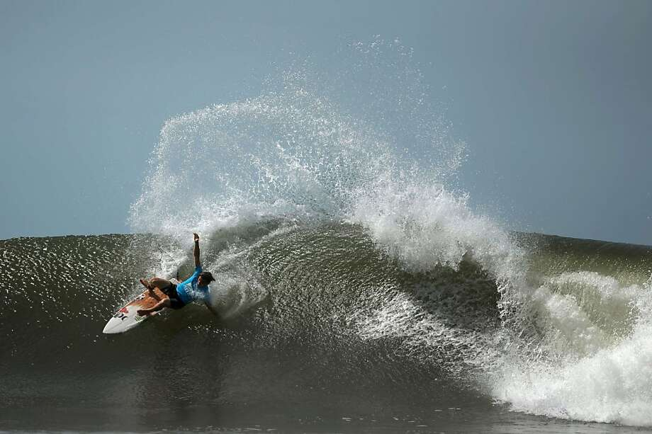 Swell cutback:Chase Wilson carves up a wave during an international surf tournament   organized by the Association of Surfing Professionals at Punta Roca Beach in La Libertad,   San Salvador. Photo: Jose Cabezas, AFP/Getty Images