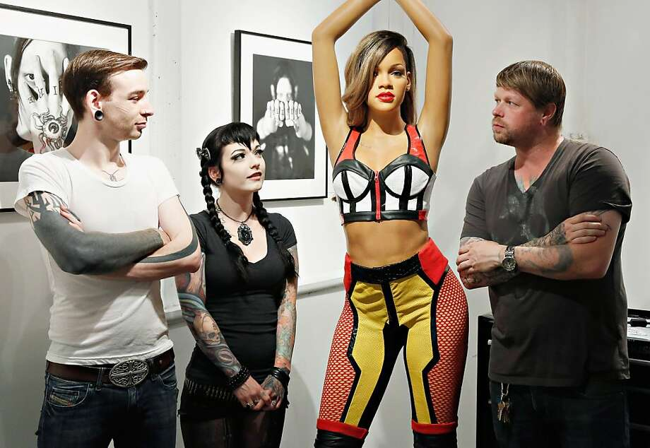 Waxwork diva: Madame Tussauds' figure of Rihanna debuts at the famed SoHo tattoo parlor Sacred Tattoo in   New York City, which is appropriate as the singer is a fan of body ink and reportedly sports   19 tattoos. Photo: Cindy Ord, Getty Images