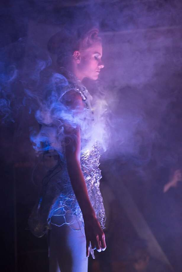 """Presumably just after triggering the sprinkler system:Designer Anouk Wipprecht's """"smoke   dress,"""" which gradually emits more and more smoke as the model moves gracefully on the   runway, makes a splash at Codame's Public Works event in San Francisco. Photo: Alex Stover"""