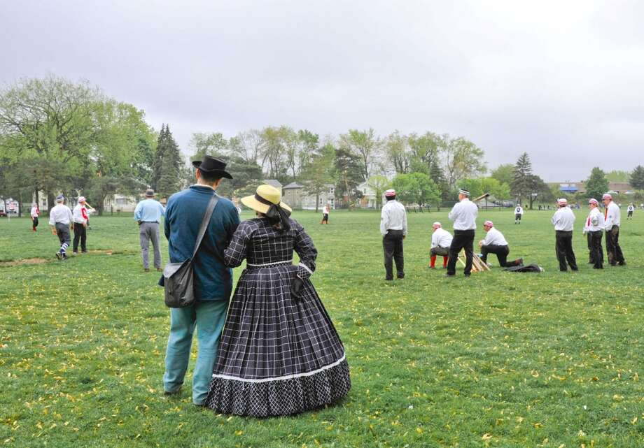 Members of the 22nd Massachusetts Volunteer Civil War Reenactors watch as teams of the Coltsville Vintage Base Ball League play a match of 1865 base ball. A game will take place on Saturday, July 13, 2013 in Easton, Conn.