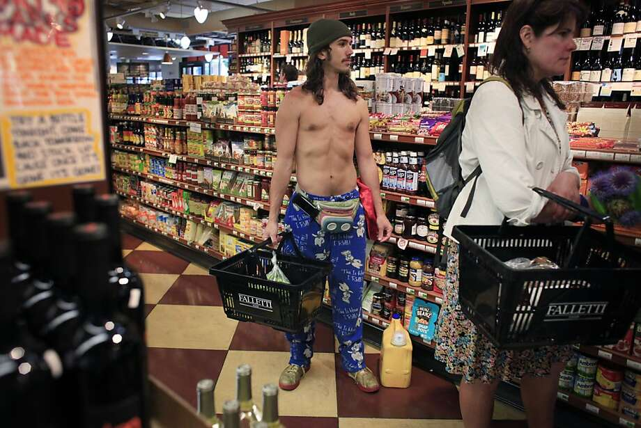 "Travis ""Topless Travis"" Sigley   buys groceries near his home in San Francisco. Photo: Mike Kepka, The Chronicle"
