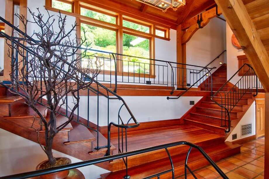 "Stairway of 10260 47th Ave. S.W., in Fauntleroy. The 6,530-square-foot mansion, built in 1989, has five bedrooms, 4.25 bathrooms, vaulted ceilings, a dining room that can fit more than 20 people, a parlor, a family room, an office, a ""crow's nest,"" and multiple decks and patios on 1.75 acres. It's listed for $2.275 million. Photo: Courtesy Scott Monroe, Windermere Real Estate"