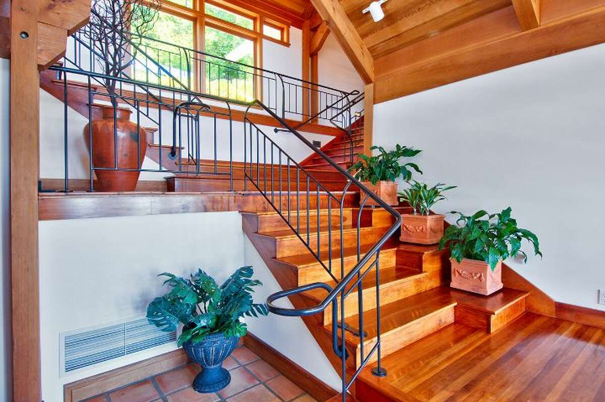 Stairway of 10260 47th Ave. S.W., in Fauntleroy. The 6,530-square-foot mansion, built in 1989, has five bedrooms, 4.25 bathrooms, vaulted ceilings, a dining room that can fit more than 20 people, a parlor, a family room, an office, a