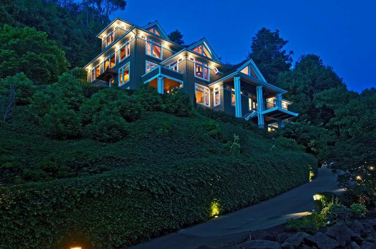 Here's a house for people who like grand stairways, wood and views: 10260 47th Ave. S.W., in Fauntleroy. The 6,530-square-foot mansion, built in 1989, has five bedrooms, 4.25 bathrooms, vaulted ceilings, a dining room that can fit more than 20 people, a parlor, a family room, an office, a