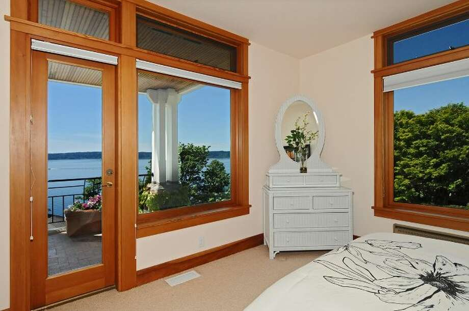 "West bedroom of 10260 47th Ave. S.W., in Fauntleroy. The 6,530-square-foot mansion, built in 1989, has five bedrooms, 4.25 bathrooms, vaulted ceilings, a dining room that can fit more than 20 people, a parlor, a family room, an office, a ""crow's nest,"" and multiple decks and patios on 1.75 acres. It's listed for $2.275 million. Photo: Courtesy Scott Monroe, Windermere Real Estate"