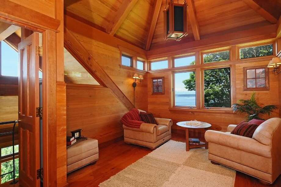 """Crow's nest"" of 10260 47th Ave. S.W., in Fauntleroy. The 6,530-square-foot mansion, built in 1989, has five bedrooms, 4.25 bathrooms, vaulted ceilings, a dining room that can fit more than 20 people, a parlor, a family room, an office, and multiple decks and patios on 1.75 acres. It's listed for $2.275 million. Photo: Courtesy Scott Monroe, Windermere Real Estate"