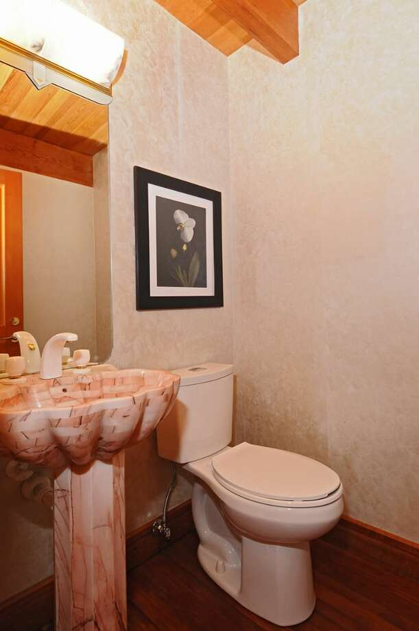 "Powder room of 10260 47th Ave. S.W., in Fauntleroy. The 6,530-square-foot mansion, built in 1989, has five bedrooms, 4.25 bathrooms, vaulted ceilings, a dining room that can fit more than 20 people, a parlor, a family room, an office, a ""crow's nest,"" and multiple decks and patios on 1.75 acres. It's listed for $2.275 million. Photo: Courtesy Scott Monroe, Windermere Real Estate"