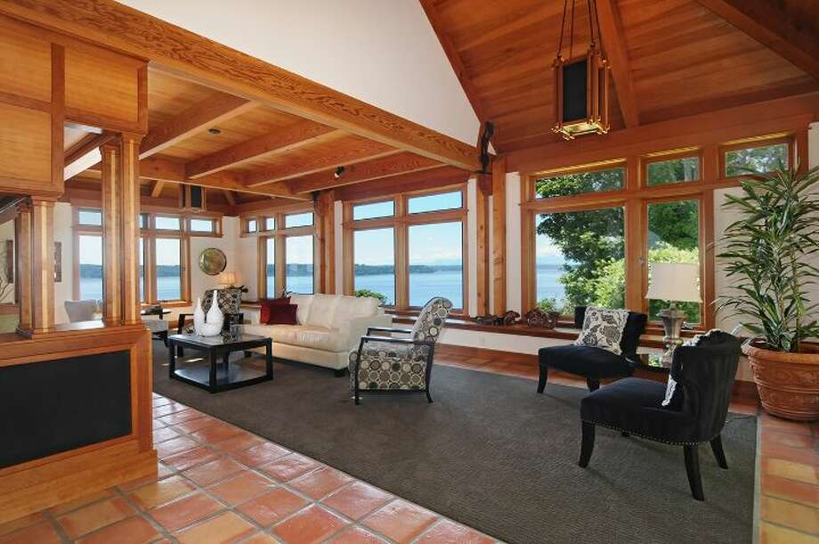 """Living room of 10260 47th Ave. S.W., in Fauntleroy. The 6,530-square-foot mansion, built in 1989, has five bedrooms, 4.25 bathrooms, vaulted ceilings, a dining room that can fit more than 20 people, a parlor, a family room, an office, a """"crow's nest,"""" and multiple decks and patios on 1.75 acres. It's listed for $2.275 million. Photo: Courtesy Scott Monroe, Windermere Real Estate"""