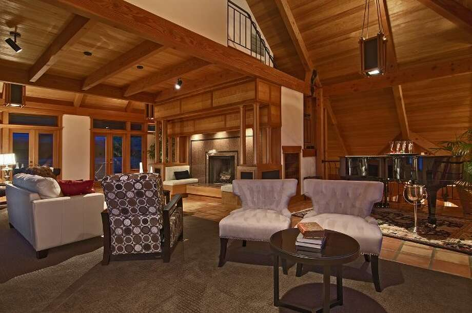 "Living room of 10260 47th Ave. S.W., in Fauntleroy. The 6,530-square-foot mansion, built in 1989, has five bedrooms, 4.25 bathrooms, vaulted ceilings, a dining room that can fit more than 20 people, a parlor, a family room, an office, a ""crow's nest,"" and multiple decks and patios on 1.75 acres. It's listed for $2.275 million. Photo: Courtesy Scott Monroe, Windermere Real Estate"