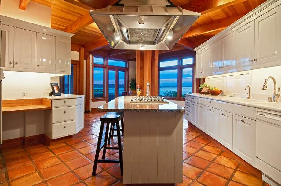 "Kitchen of 10260 47th Ave. S.W., in Fauntleroy. The 6,530-square-foot mansion, built in 1989, has five bedrooms, 4.25 bathrooms, vaulted ceilings, a dining room that can fit more than 20 people, a parlor, a family room, an office, a ""crow's nest,"" and multiple decks and patios on 1.75 acres. It's listed for $2.275 million. Photo: Courtesy Scott Monroe, Windermere Real Estate"