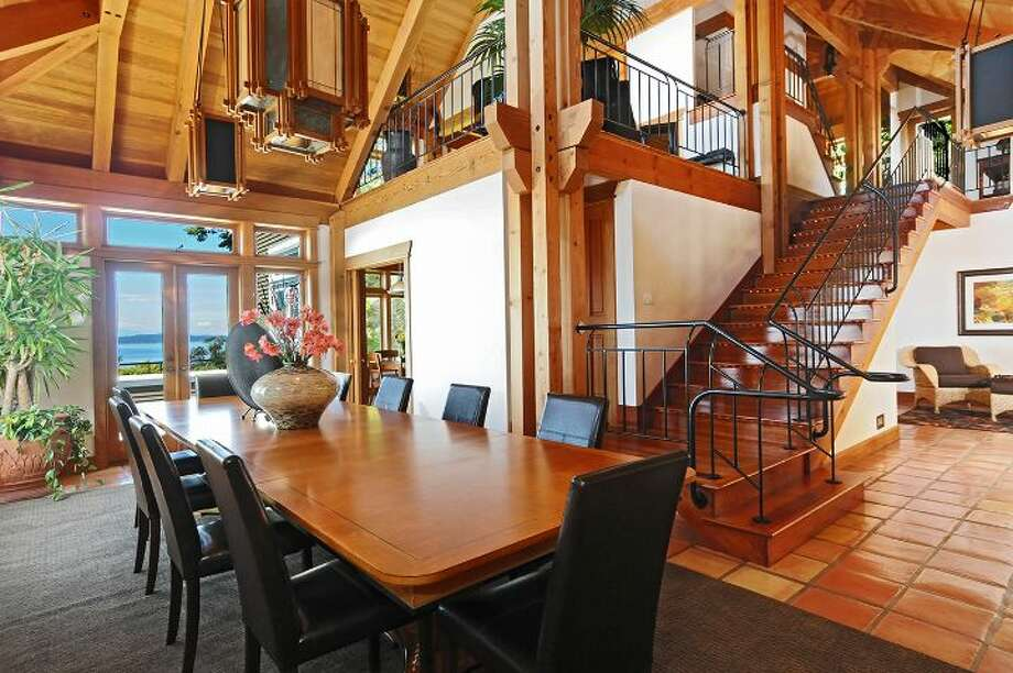 "Dining room of 10260 47th Ave. S.W., in Fauntleroy. The 6,530-square-foot mansion, built in 1989, has five bedrooms, 4.25 bathrooms, vaulted ceilings, a parlor, a family room, an office, a ""crow's nest,"" and multiple decks and patios on 1.75 acres. It's listed for $2.275 million. Photo: Courtesy Scott Monroe, Windermere Real Estate"