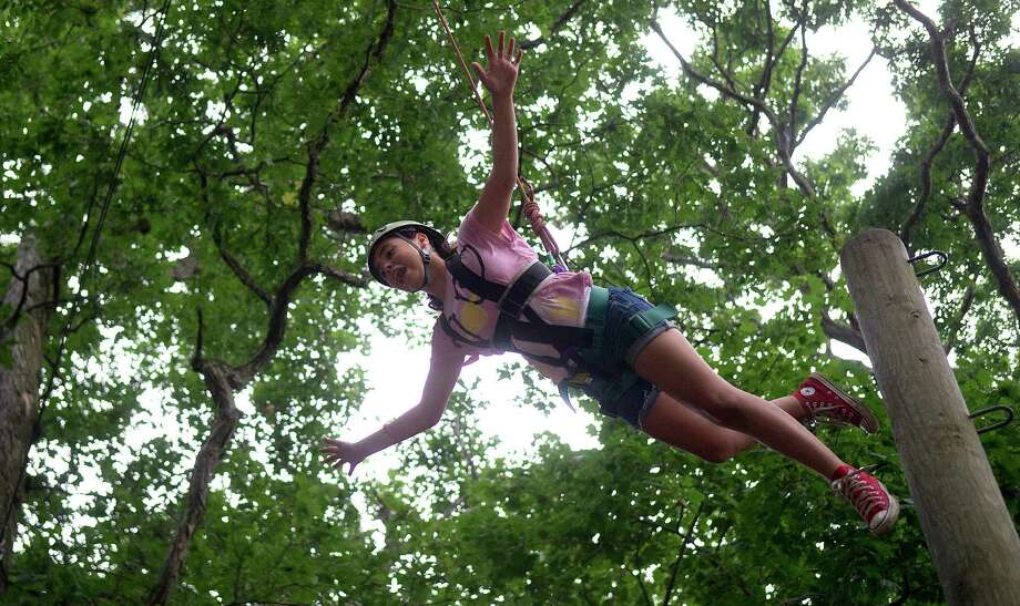 Francesca Ordonez participates in the ropes course at Scalzi Park during Pathfinders Adventure Camp on Friday, July 12, 2013. Photo: Lindsay Perry / Stamford Advocate