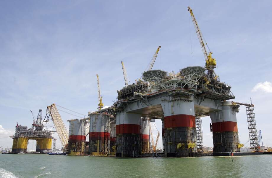 Shell's tension leg platform named Olympus (left) and Chevron's tension leg platform named Big Foot (second from right) and semi-submersible platform named Jack / St Malo ( right) are shown under construction at Kiewit Offshore Services. ( Melissa Phillip / Houston Chronicle ) Photo: Melissa Phillip, Houston Chronicle