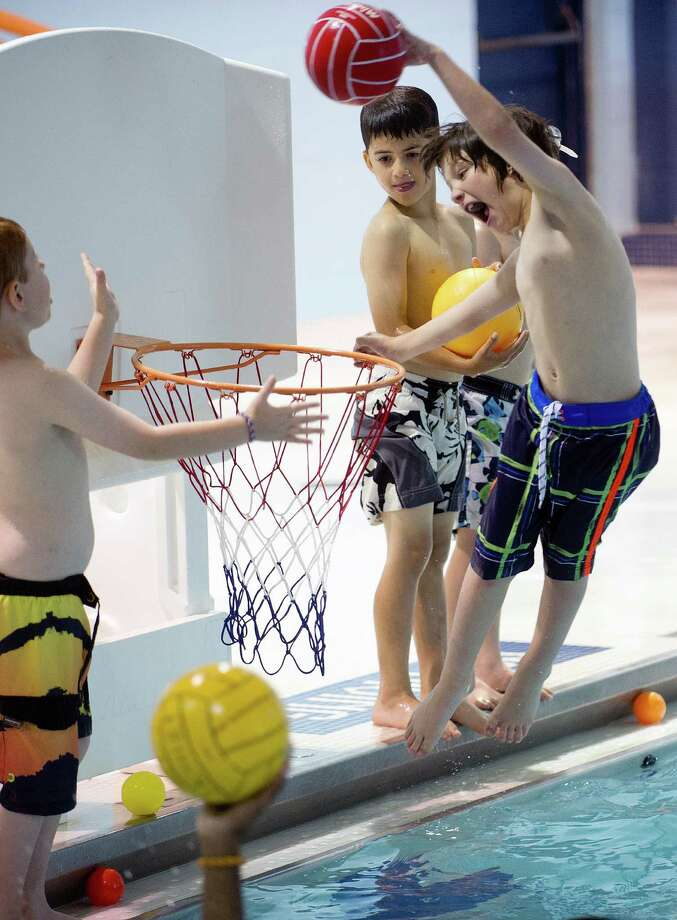 Zachary Price makes a basket as he plays in free swim during O-la-mi camp at the Stamford Jewish Community Center on Tuesday, July 9, 2013. Photo: Lindsay Perry / Stamford Advocate