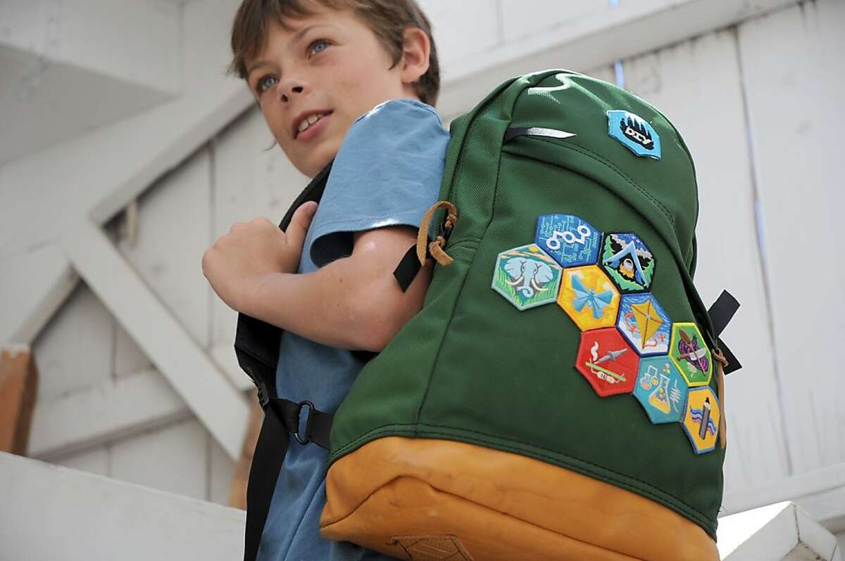 """DIY.org's scouting-style patches earned by youthful """"makers"""" are meant to be affixed to backpacks."""
