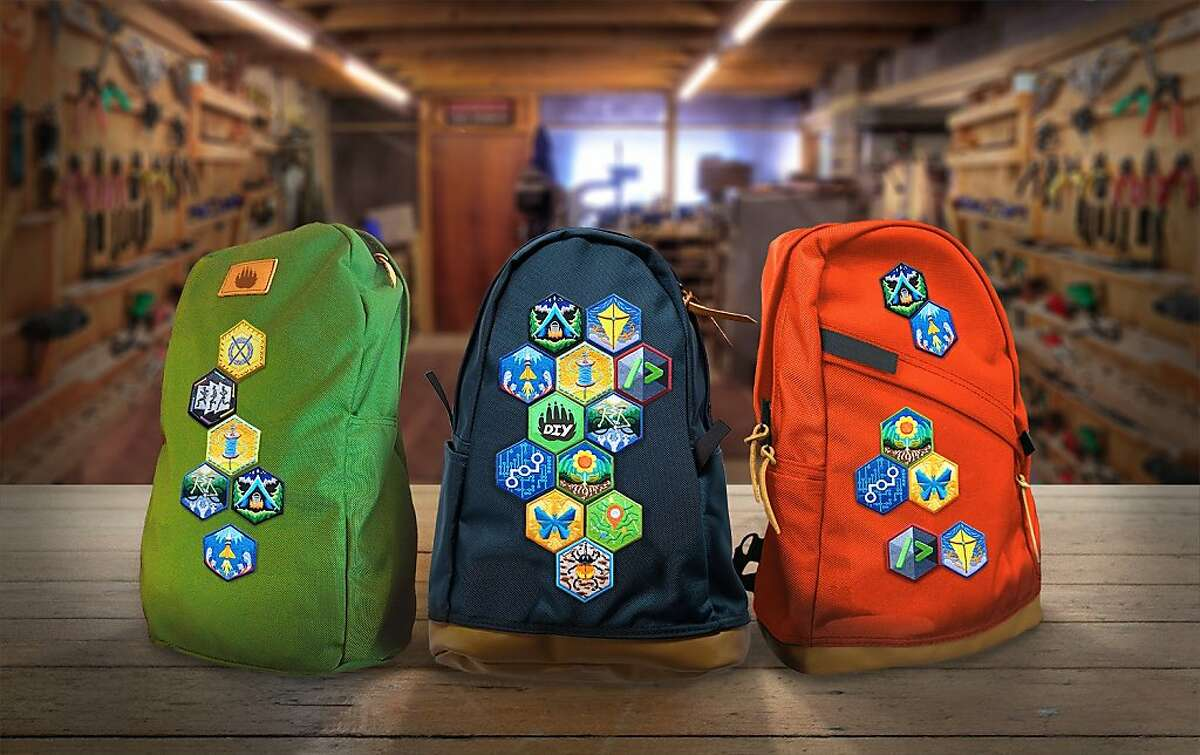 """Image shows some of DIY.org's """"merit badges"""" affixed to a backpack. Photo by Isaiah Saxon, via DIY.org"""